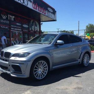 BMW X6 with Hamann Wide body kit with Vossen VFS2 in silver polish 22x12 rear and 22x10.5 fronts on Pirelli tires.